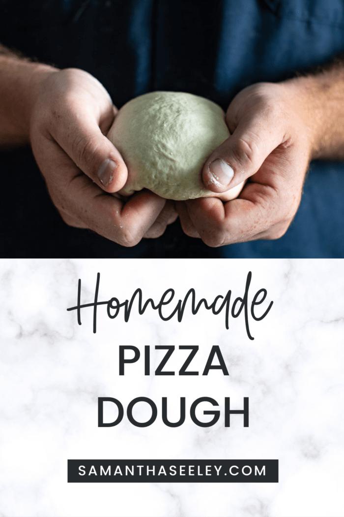 hands holding pizza dough